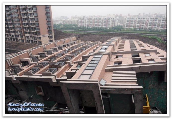 سقوط بناية في الصين
