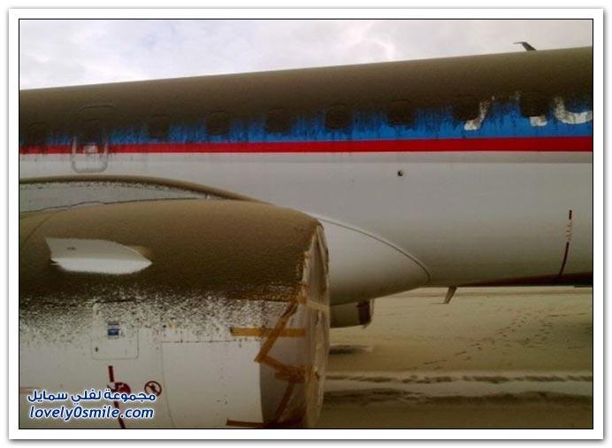 صور لطائرة مغطاة بالرماد البركاني