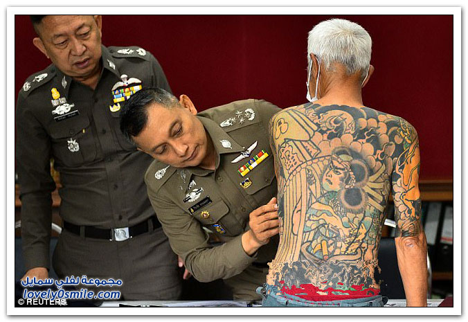 وشوم يؤدي لاعتقال عضو عصابة ياباني متهم بالقتل في تايلاند