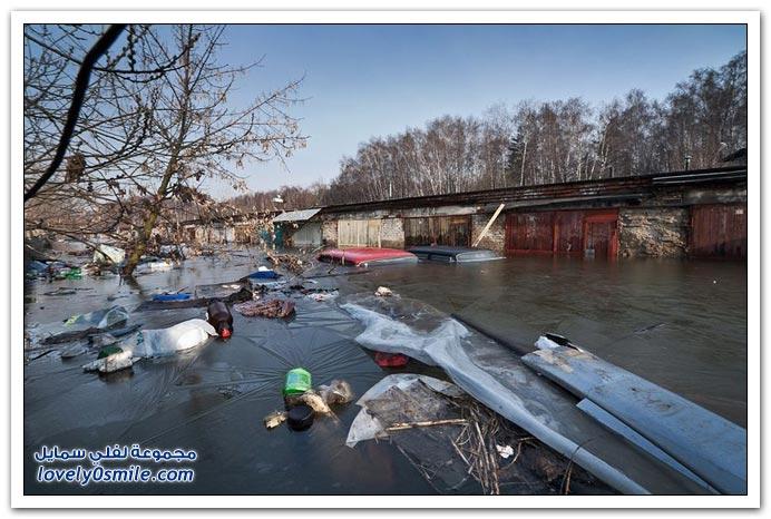 صور السيارات الغارقة في أحد الفيضانات الروسية